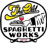 spaghetti works text with waiters hand holding pasta and wine