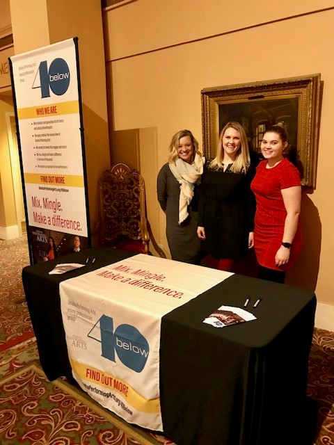40 Below volunteers stand behind a booth at the Orpheum THeater