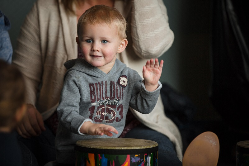 A little boy plays the drum in WeBop